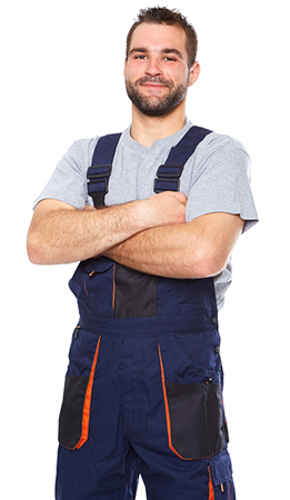 Portrait of smiling worker in blue uniform