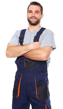 Portrait of smiling worker in blue uniform